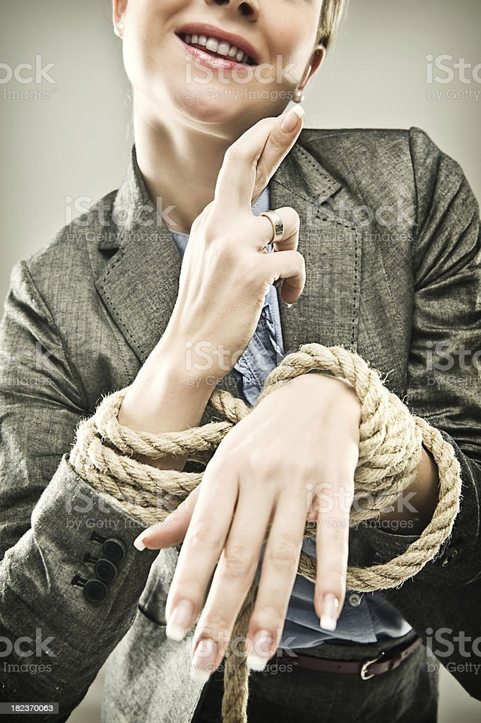 Businesswoman series - hands tied fingers crossed royalty-free stock photo