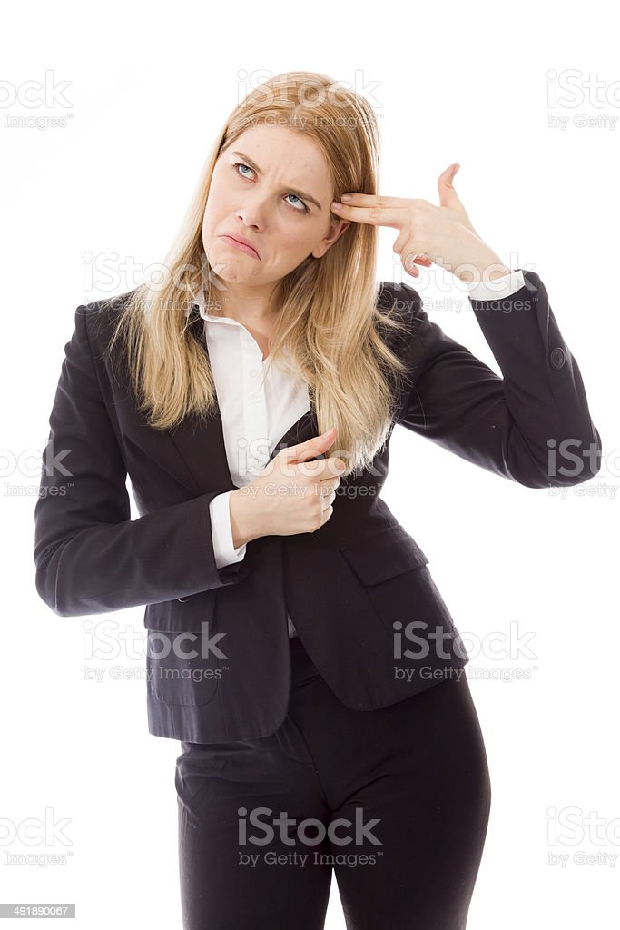 Businesswoman shooting self in head stock photo