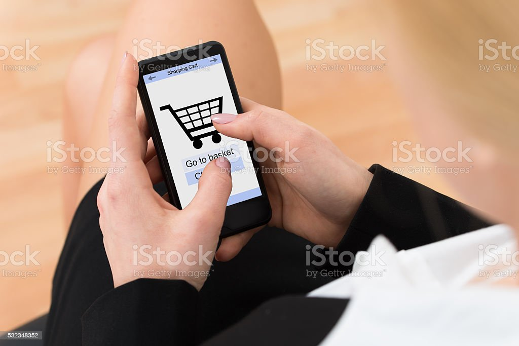 Businesswoman Shopping Online On Mobile Phone stock photo