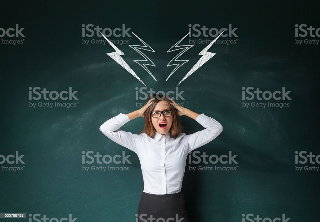 Businesswoman shouting and standing under drawn lightnings over stock photo