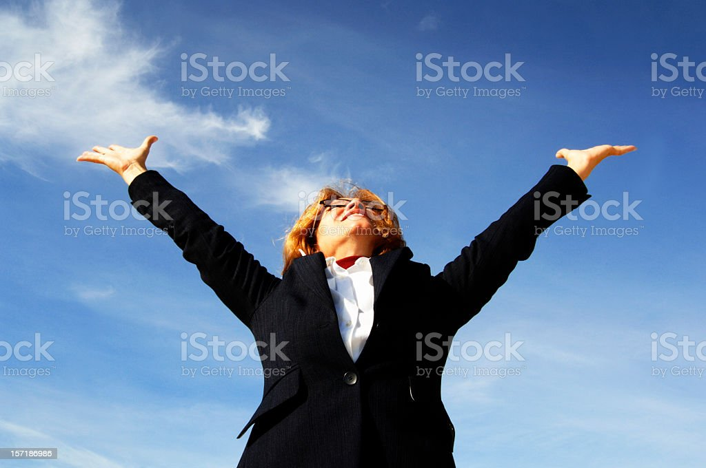 Businesswoman shouting her victory to the world royalty-free stock photo