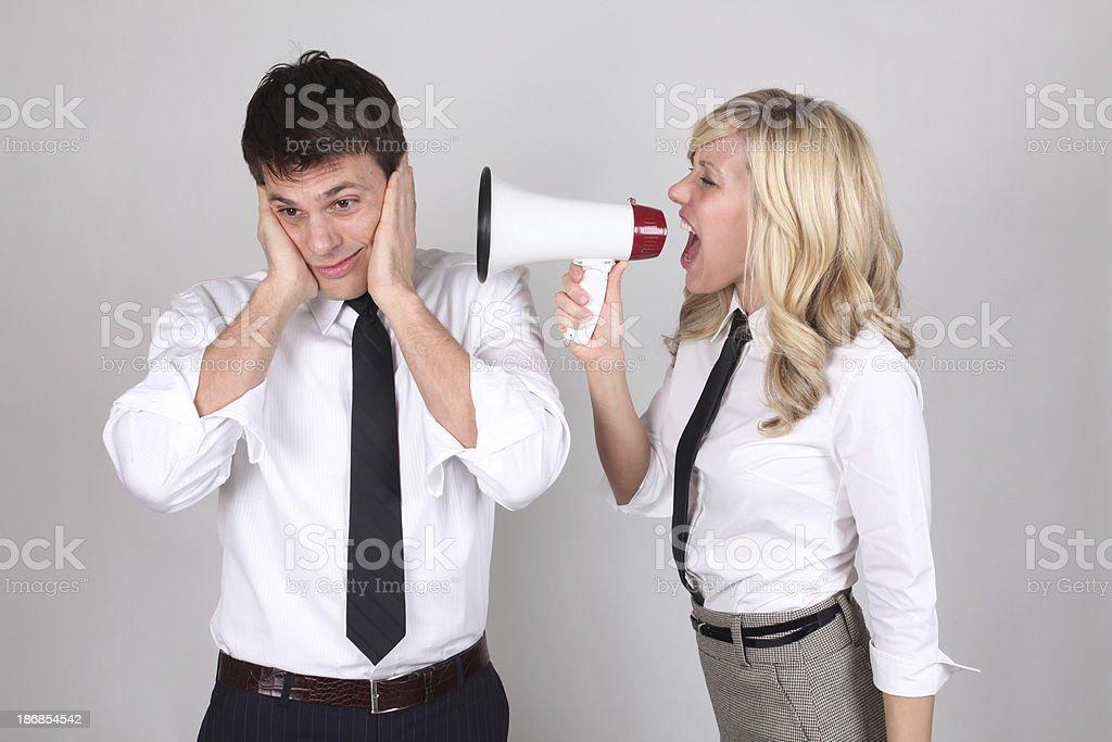 Businesswoman shouting in megaphone stock photo