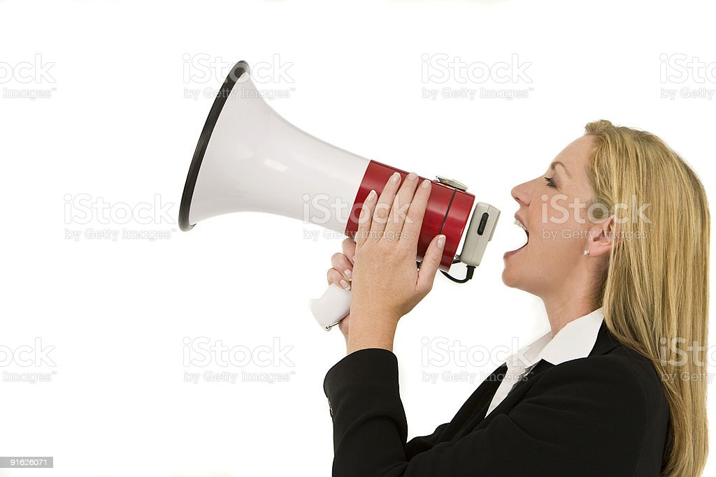 Businesswoman Shouting Into A Megaphone or Bullhorn royalty-free stock photo
