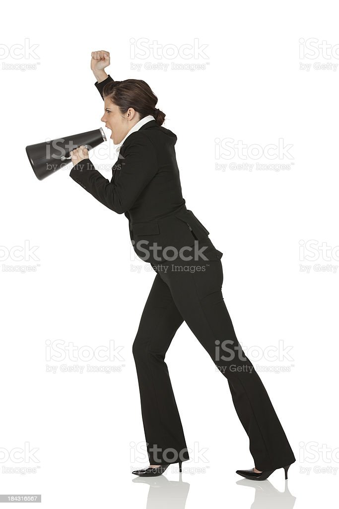 Businesswoman shouting into a megaphone royalty-free stock photo