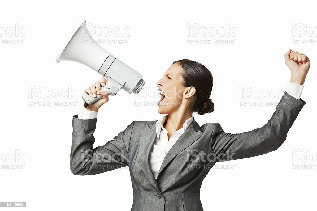Businesswoman Shouting Over a Bullhorn - Isolated royalty-free stock photo