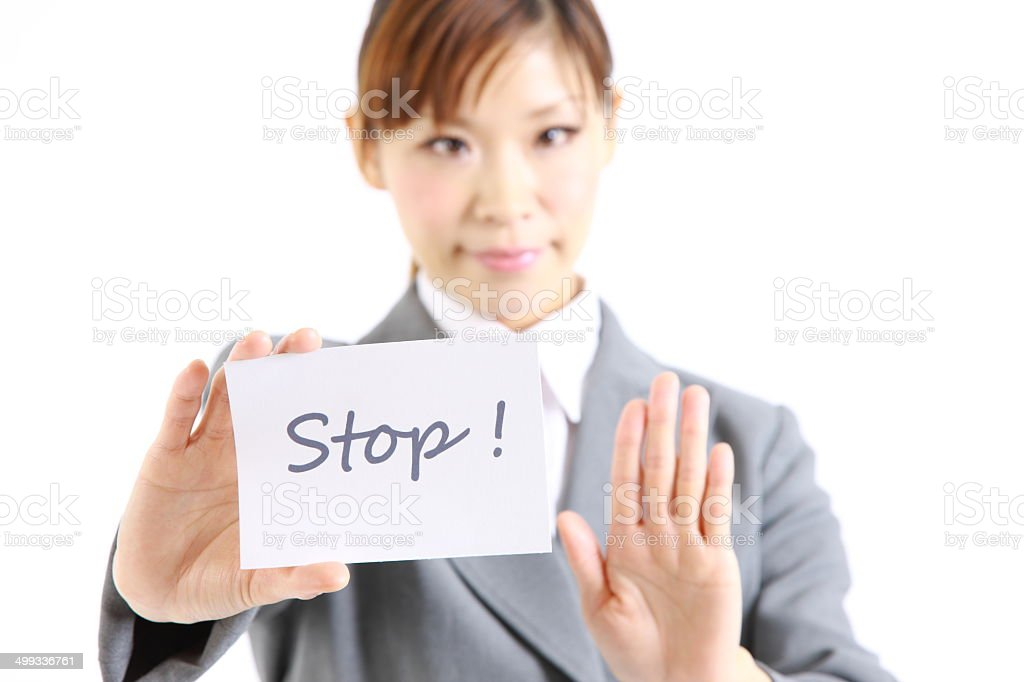 Businesswoman showing a card with word 'Stop' stock photo