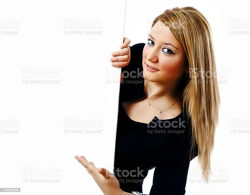 Businesswoman showing blank billboard sign stock photo