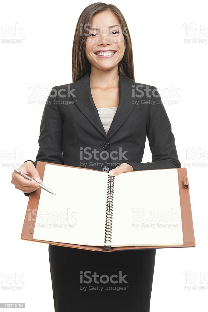 Businesswoman showing blank notebook copyspace royalty-free stock photo