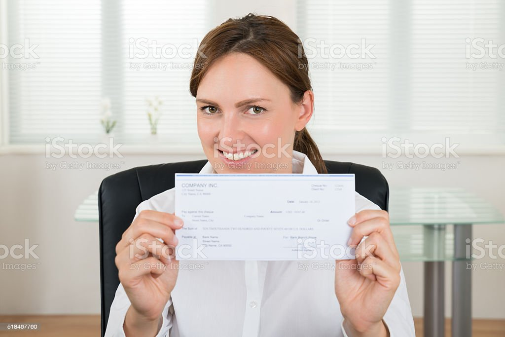 Businesswoman Showing Cheque stock photo