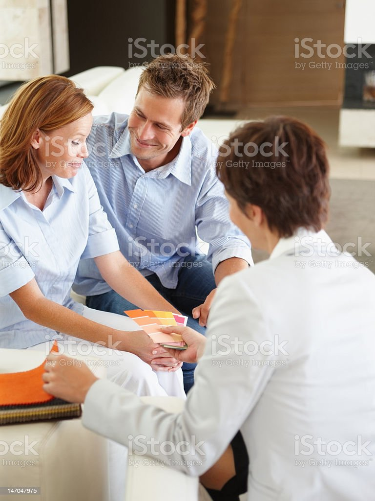 Businesswoman showing color pads to young couple royalty-free stock photo