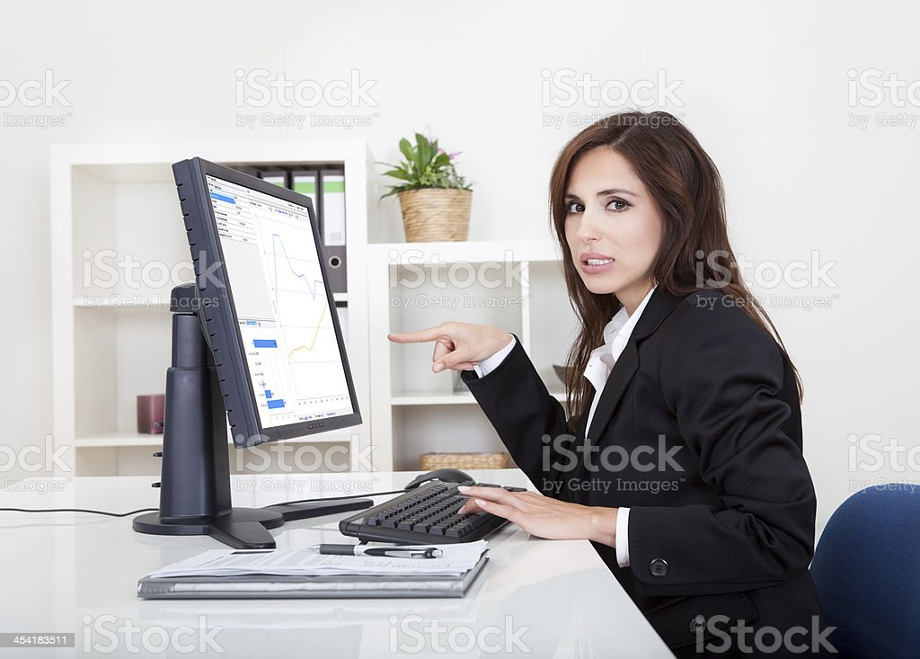 Businesswoman Showing Graph stock photo