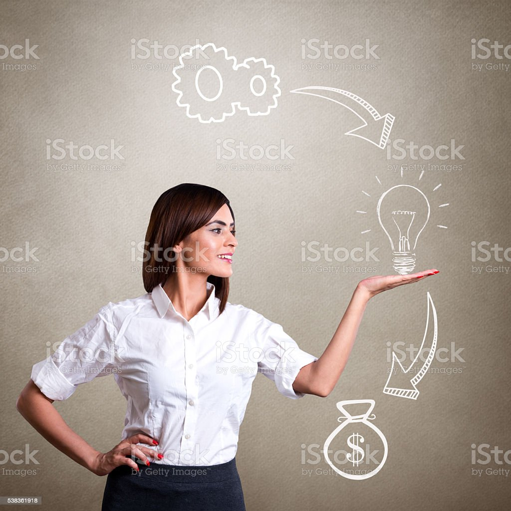 Businesswoman showing info-graphic of success stock photo