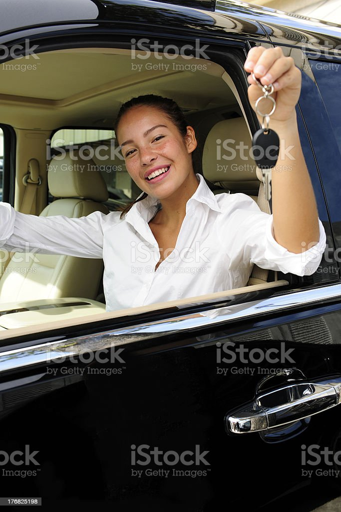 businesswoman showing keys of her new car royalty-free stock photo