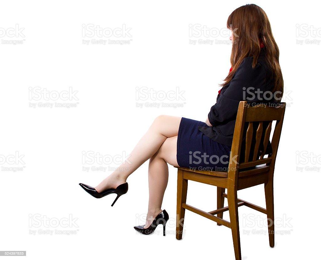 Businesswoman showing off heels stock photo