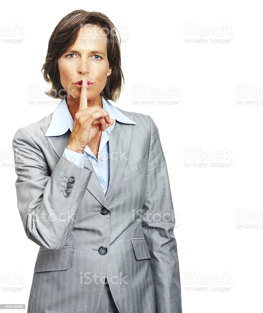 Businesswoman showing silence sign royalty-free stock photo