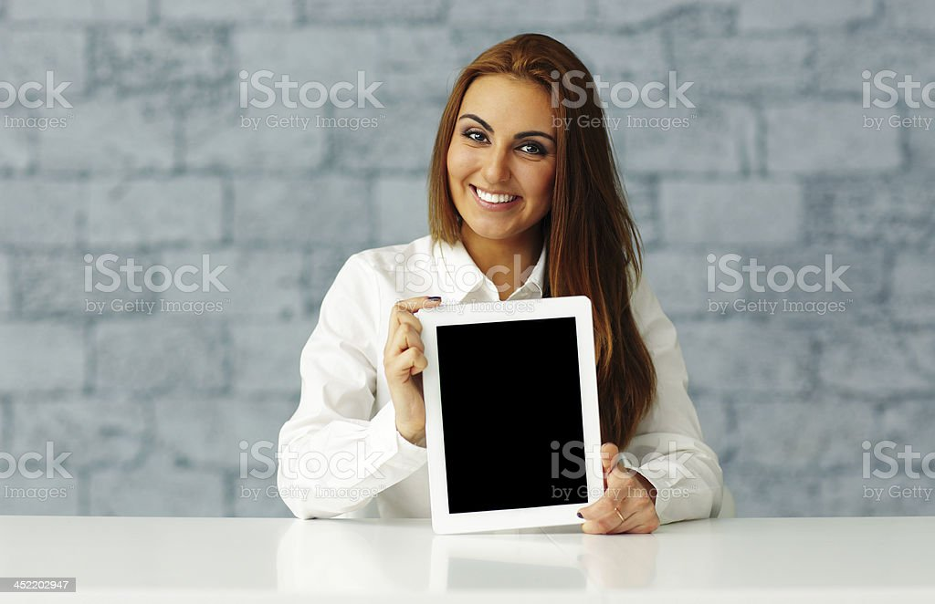 businesswoman showing tablet computer display stock photo