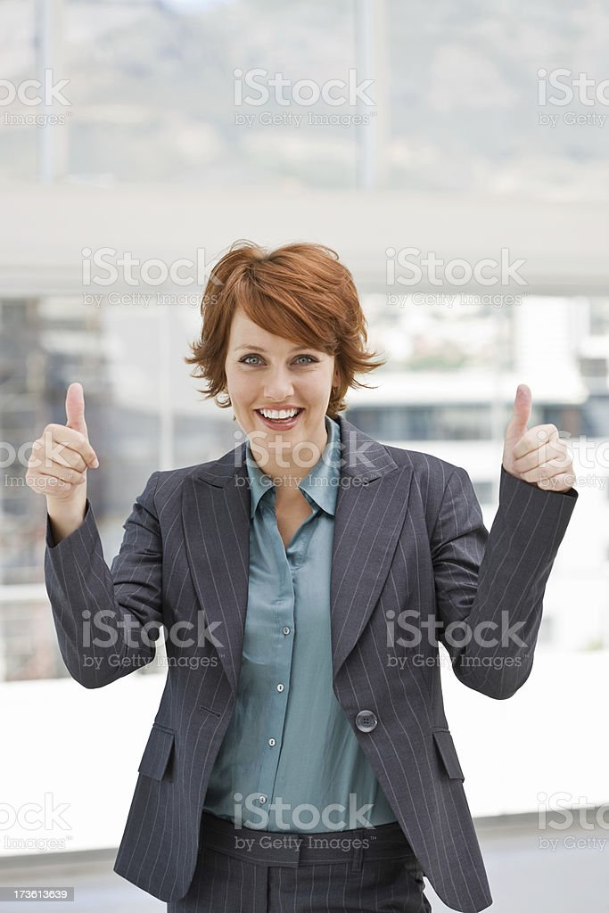 Businesswoman showing thumb's up sign royalty-free stock photo