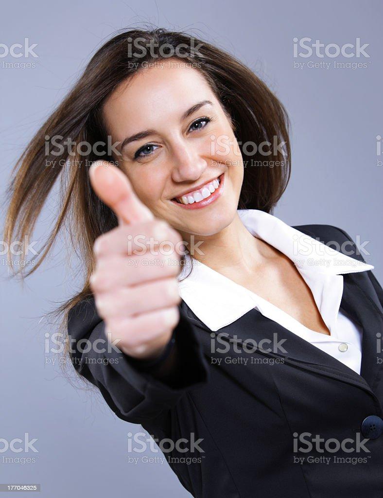 Femme d'affaires montre signe de pouce levé photo libre de droits