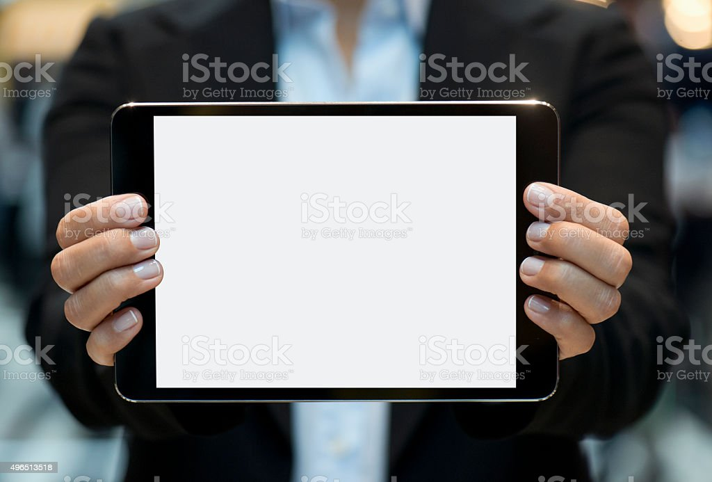 Businesswoman showing touchpad stock photo