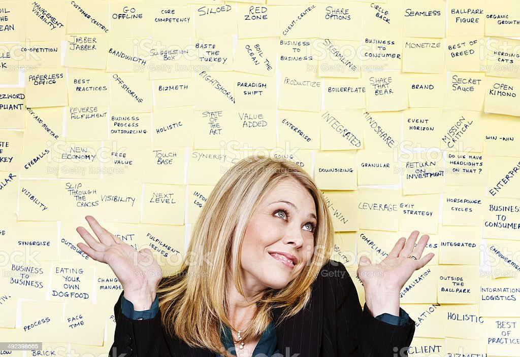 Businesswoman shrugs, confused by multiple messages on noticeboard stock photo