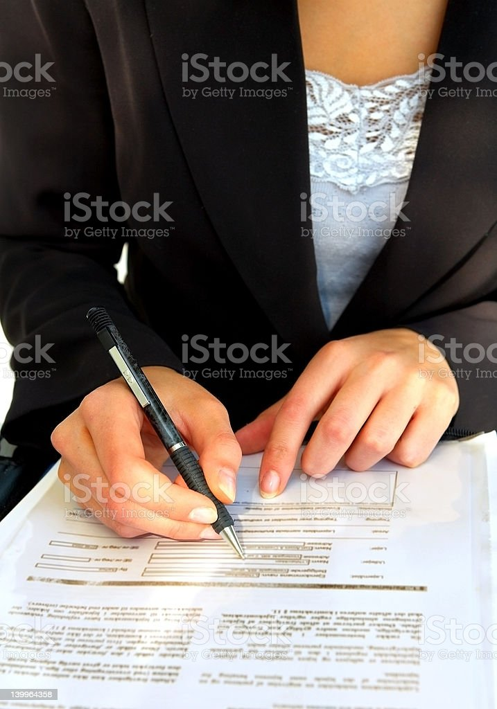 Businesswoman signing a contract royalty-free stock photo