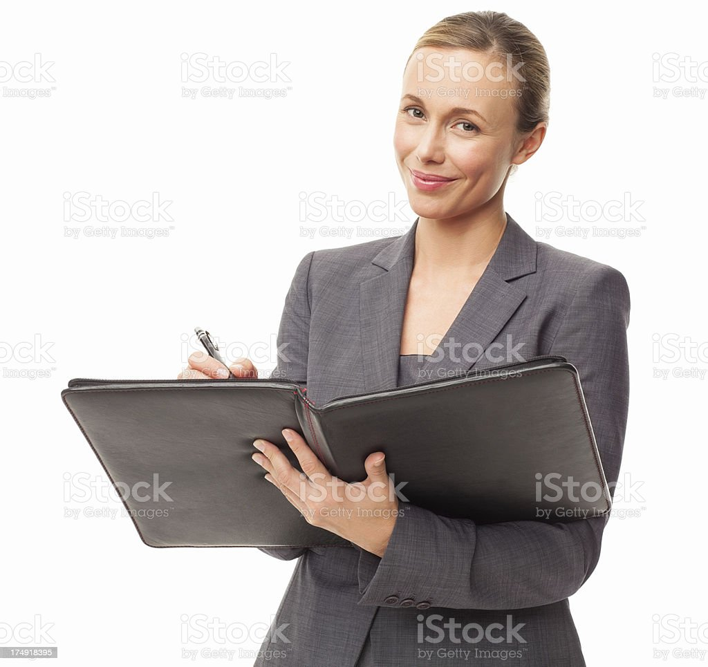 Businesswoman Signing a Document - Isolated royalty-free stock photo