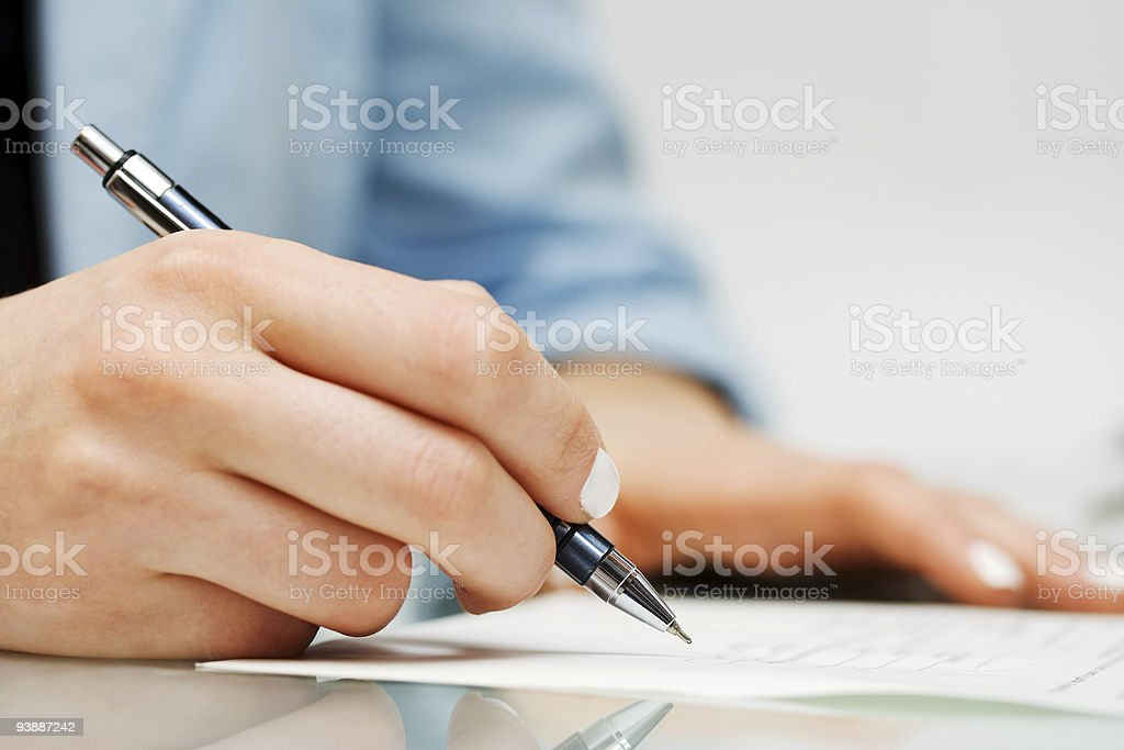 Businesswoman signing contract stock photo