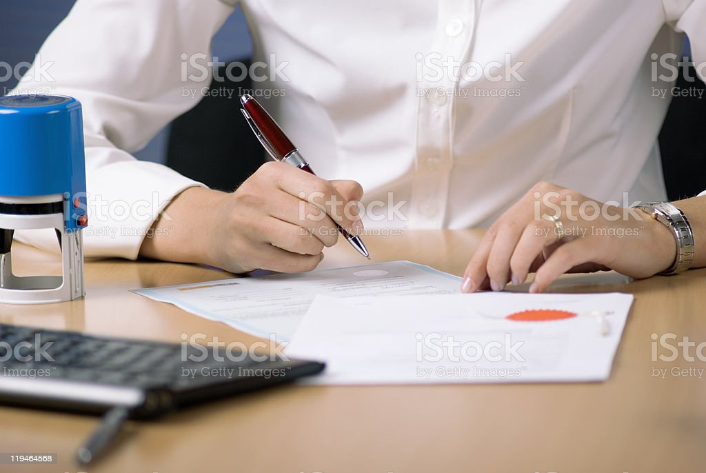 Businesswoman signing document stock photo