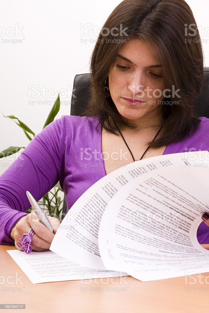 businesswoman signing documents royalty-free stock photo