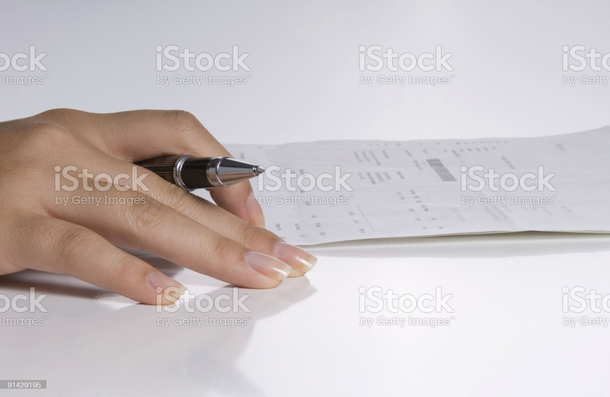 Businesswoman signing papers, Hand, close-up royalty-free stock photo