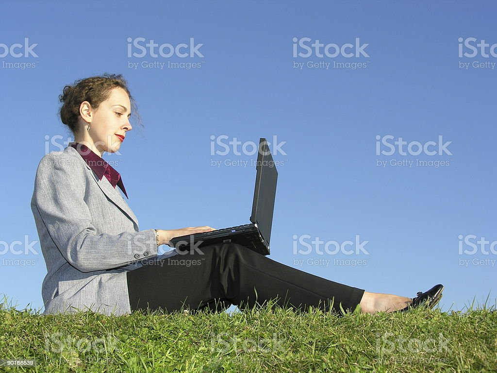 businesswoman sit with notebook on blue sky royalty-free stock photo