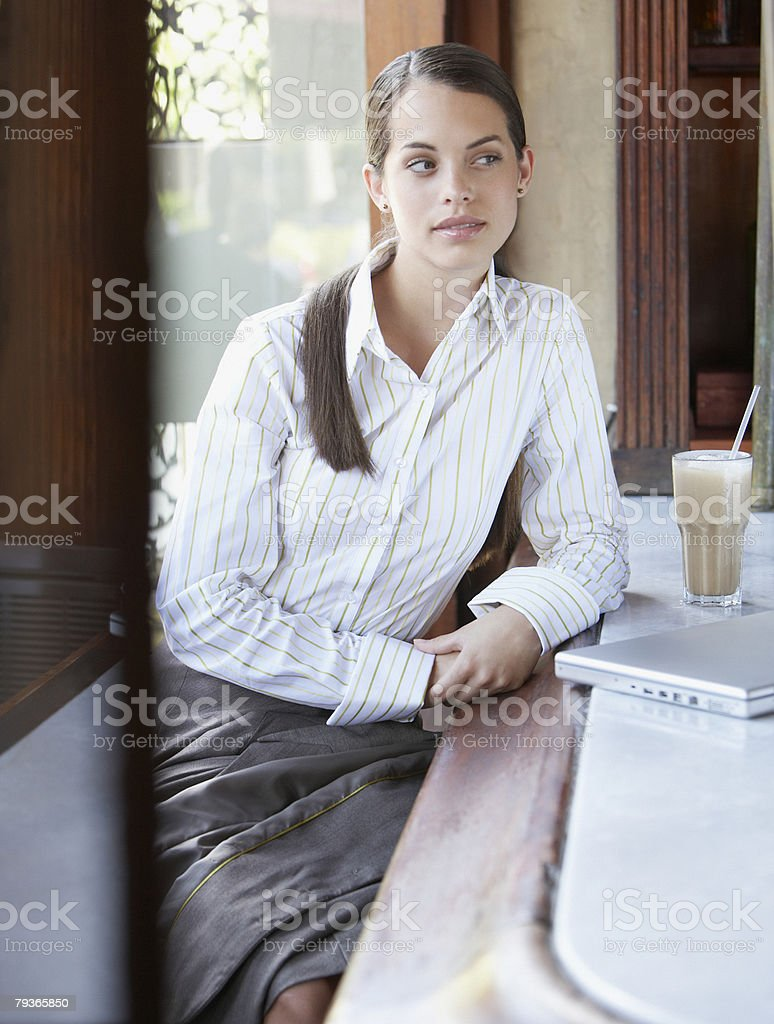 Businesswoman sitting at bar with laptop royalty-free stock photo