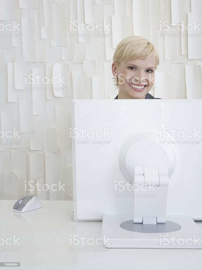 Businesswoman sitting at computer in office royalty-free stock photo