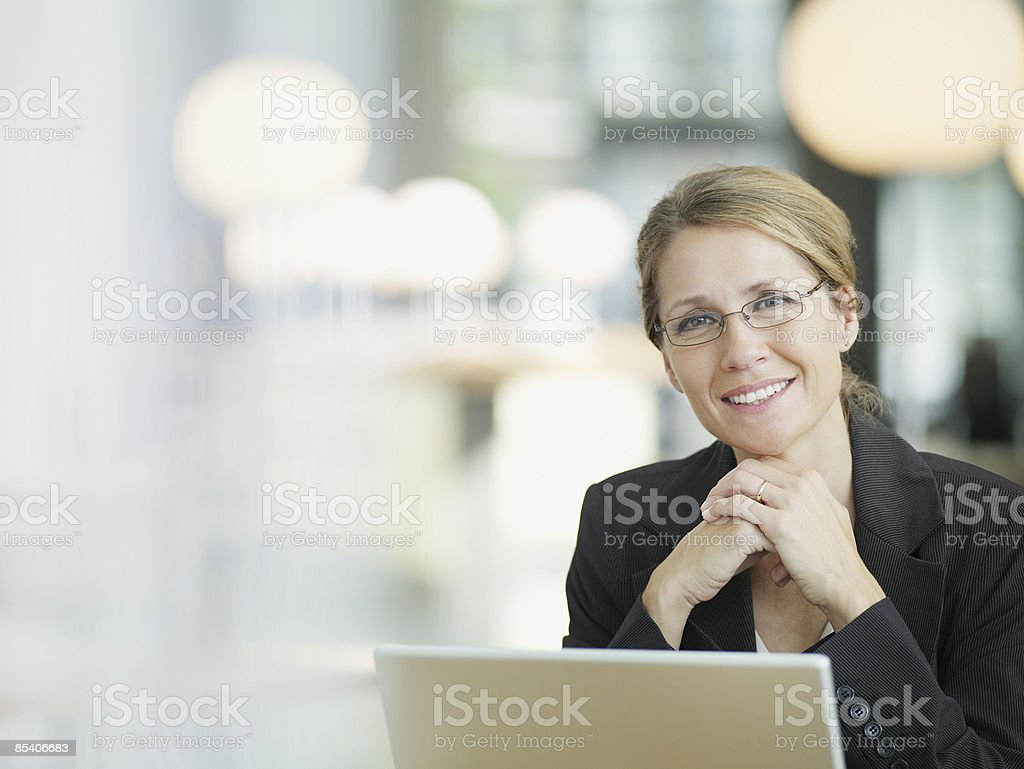 Businesswoman sitting at desk stock photo