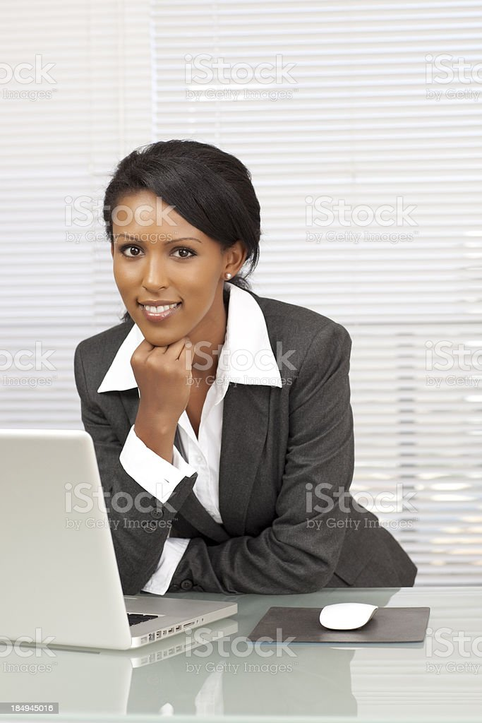Businesswoman sitting at office desk royalty-free stock photo