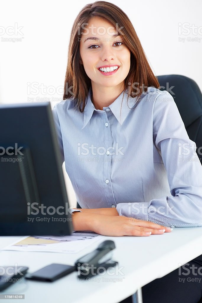 Businesswoman sitting at table stock photo