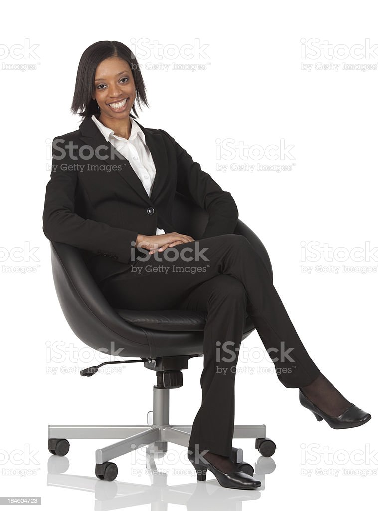 Businesswoman sitting in a chair royalty-free stock photo