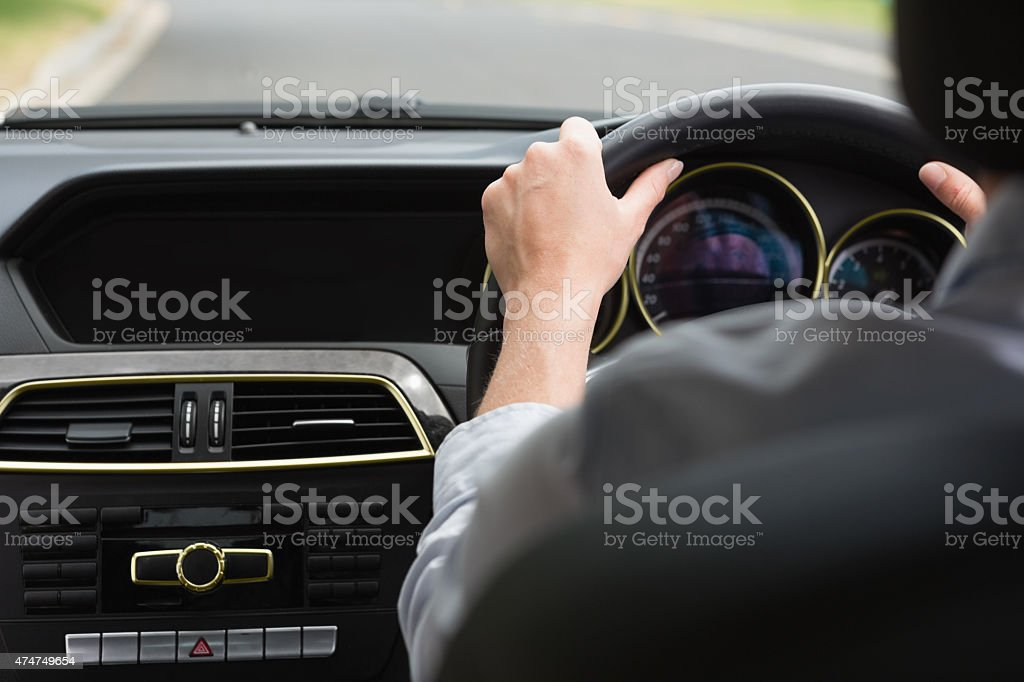 Businesswoman sitting in drivers seat stock photo