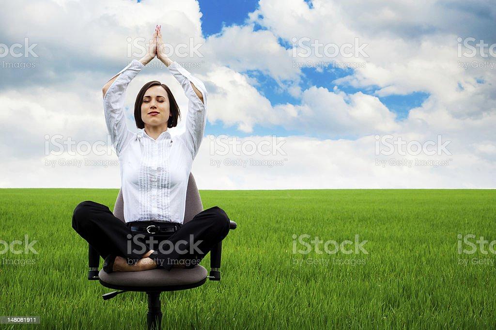 businesswoman sitting in lotus royalty-free stock photo