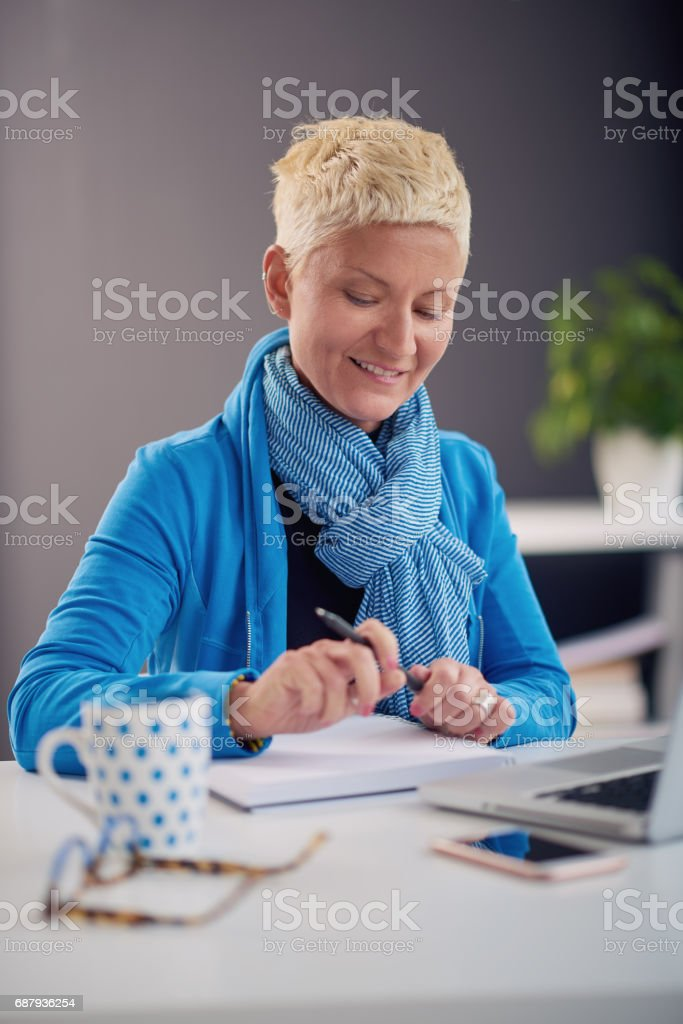 Businesswoman sitting in modern office stock photo