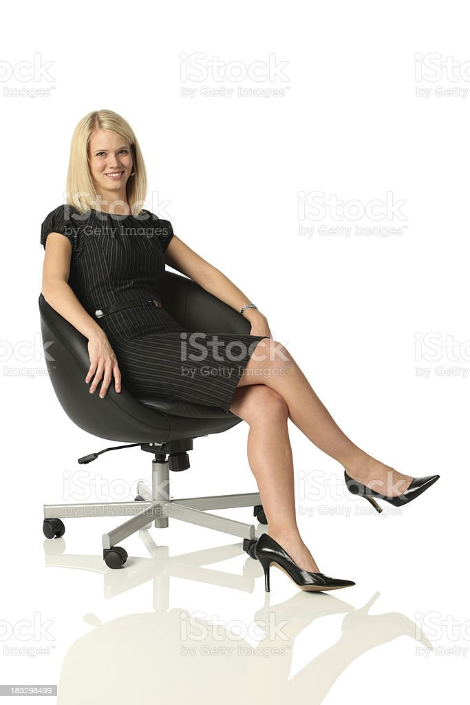 Businesswoman sitting in office chair royalty-free stock photo