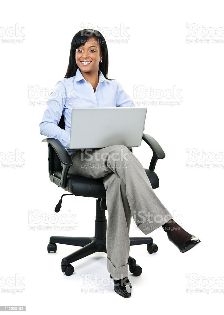 Businesswoman sitting in office chair with computer royalty-free stock photo