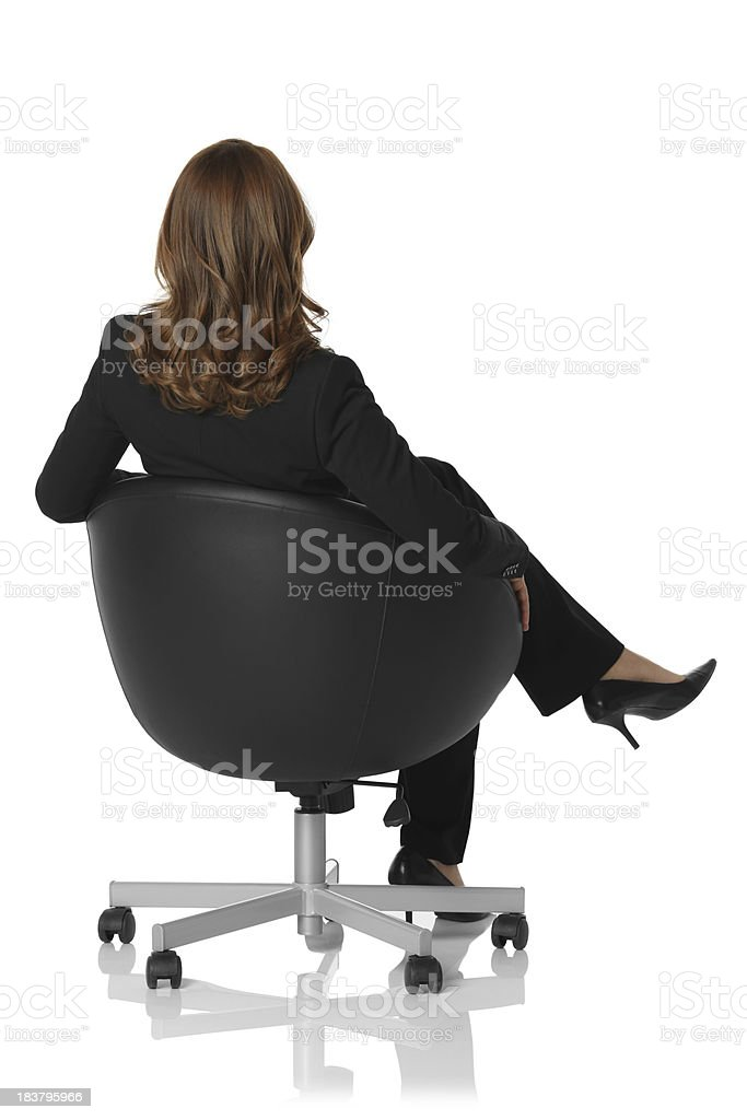 Businesswoman sitting on a chair stock photo