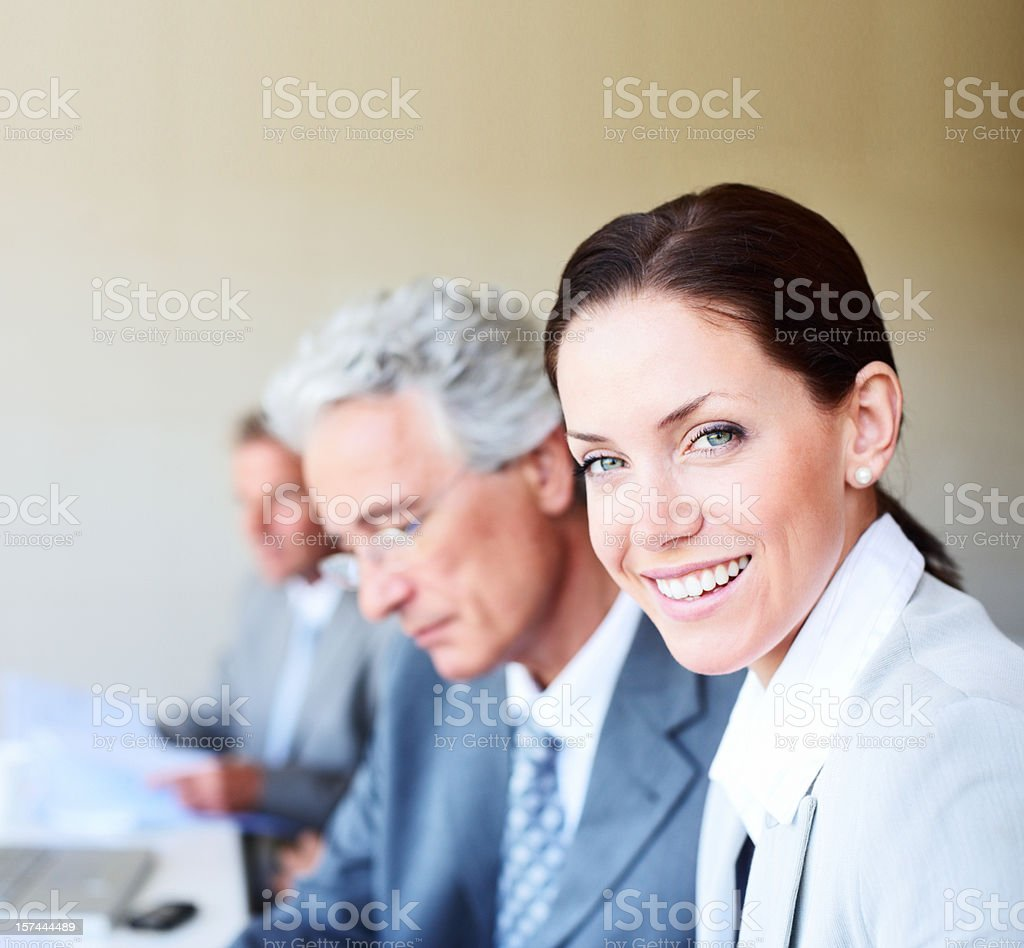 Businesswoman sitting with her colleagues royalty-free stock photo