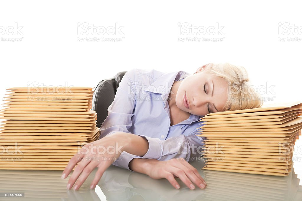 Businesswoman sleeping at her desk royalty-free stock photo