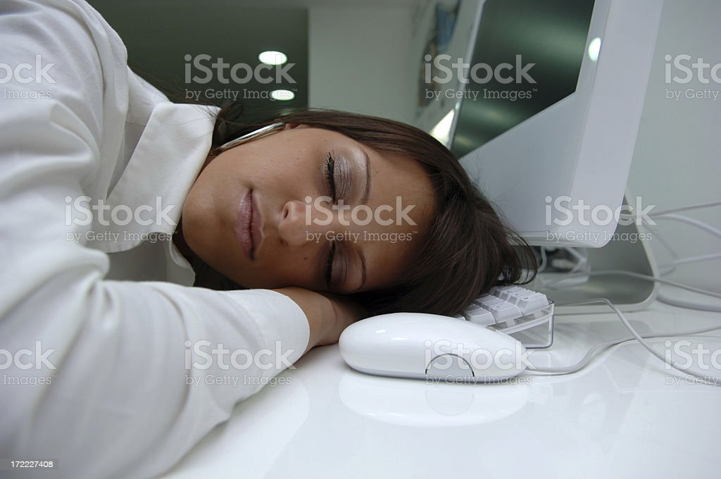businesswoman sleeping at work royalty-free stock photo