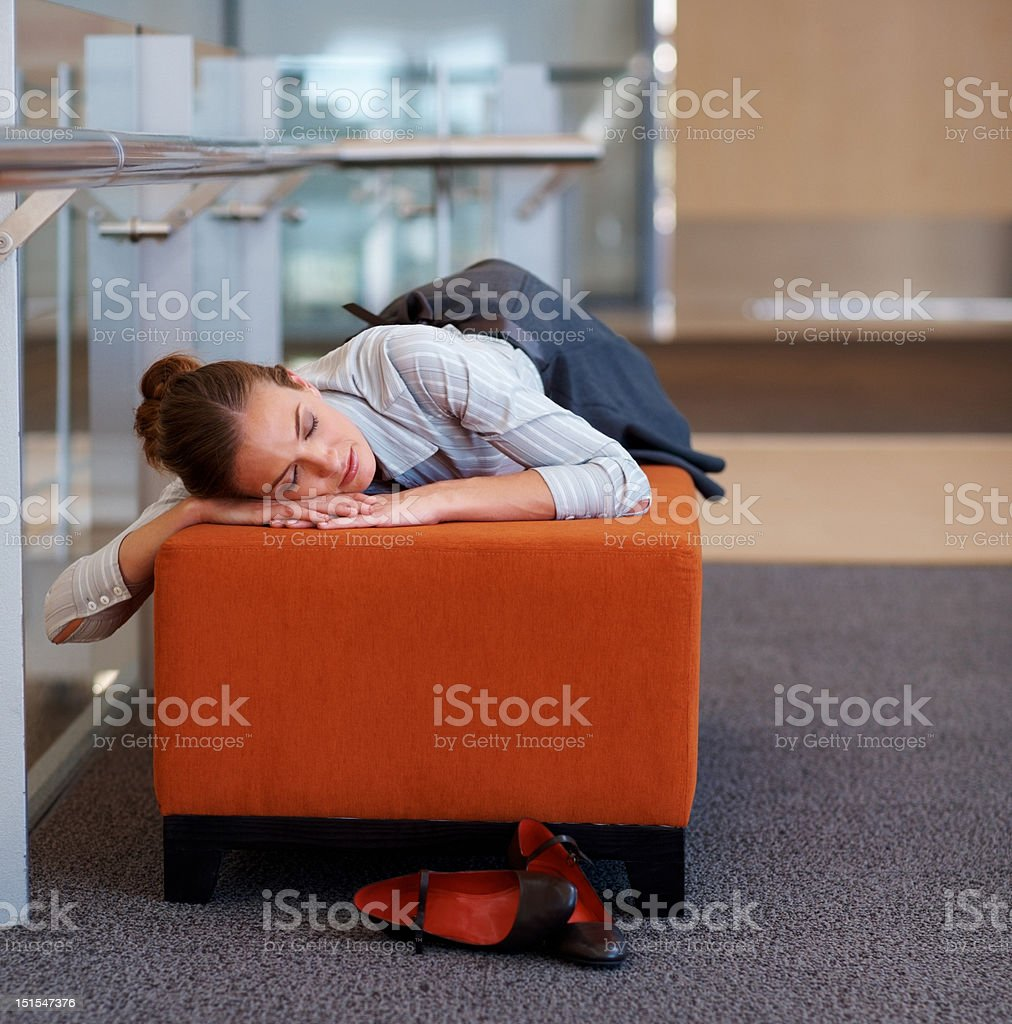 Businesswoman sleeping on couch royalty-free stock photo