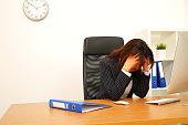 Businesswoman sleeping on desk