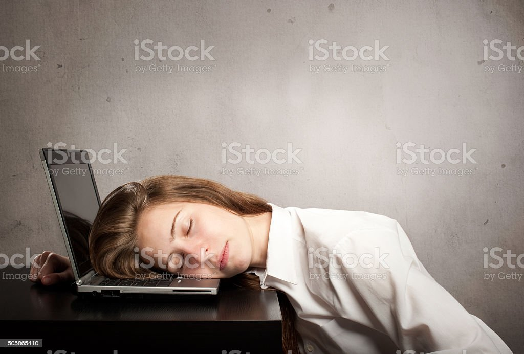 businesswoman sleeping on laptop stock photo