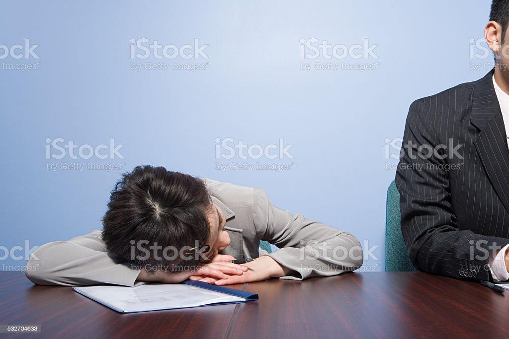 Businesswoman sleeping stock photo